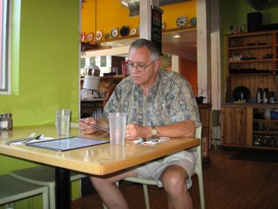 I'm checking the menu at Blue Plate Cafe.  Our favorite for a weekend breakfast.