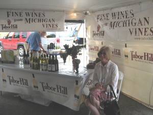 My lovely wife Sue relaxing at the Tabor Hill Winery booth.